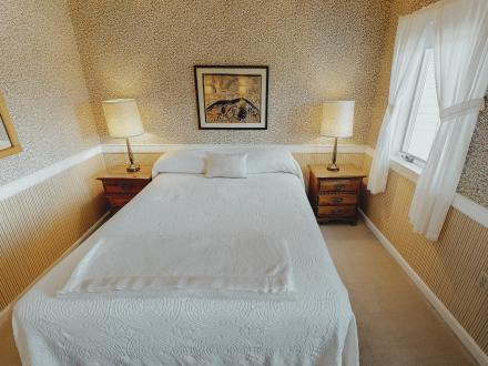 Garbo Suite features a single queen bed, with amazing lake views!